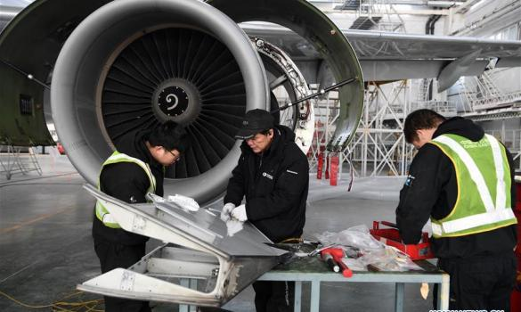 Technicians check plane at subsidiary of China Eastern Airline in NW China's Gansu